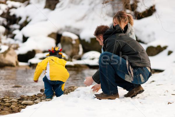 Family having winter walk at river Stock photo © Kzenon