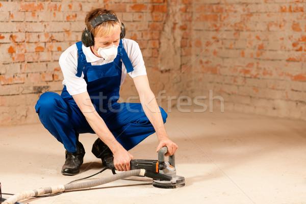 Sanding the cement floor Stock photo © Kzenon
