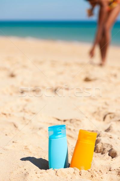 Suncream at the beach Stock photo © Kzenon