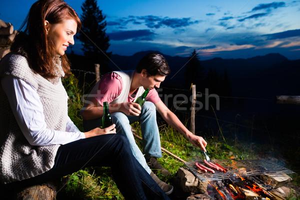 Alpler çift kamp ateşi dağlar oturma Stok fotoğraf © Kzenon