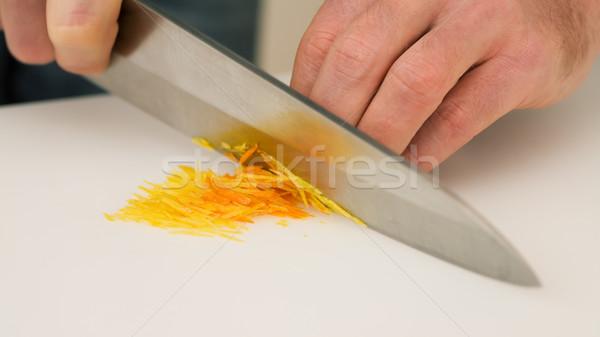 Cutting orange peel Stock photo © Kzenon