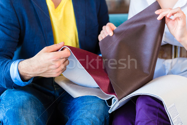 Couple picking couch seat cover in furniture store Stock photo © Kzenon