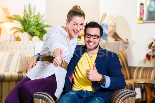 Couple buying armchair in furniture store Stock photo © Kzenon