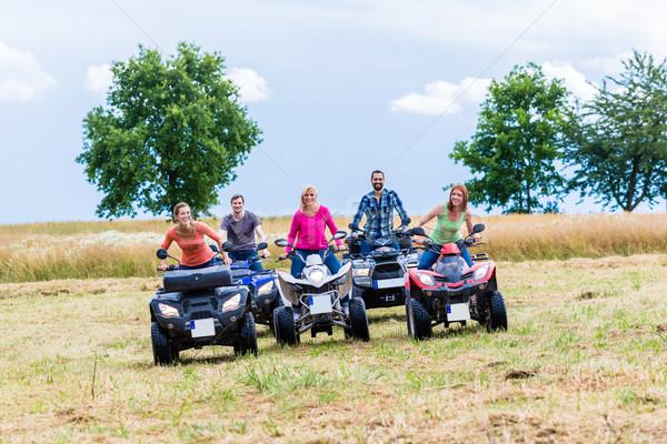 Friends driving off-road with quad bike or ATV Stock photo © Kzenon