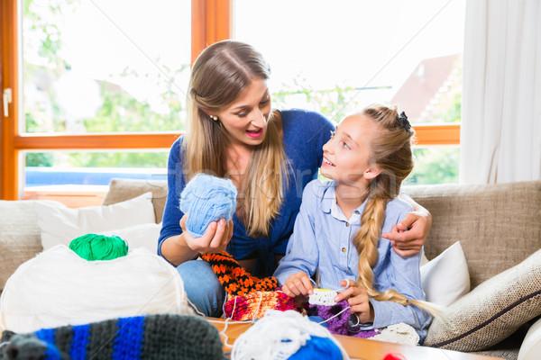 Mother teaching daughter knitting Stock photo © Kzenon
