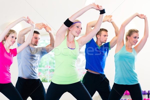 Group of fitness people in gym at aerobics Stock photo © Kzenon
