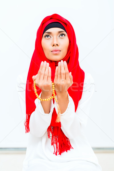 Asian Muslim woman praying with beads chain Stock photo © Kzenon