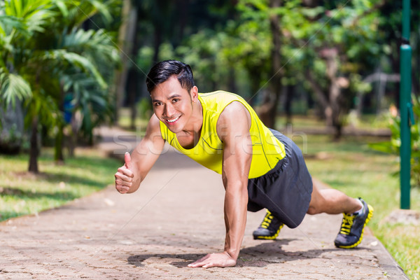 Proud and successful man doing sport push-up Stock photo © Kzenon
