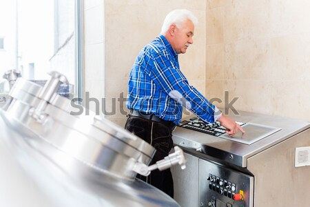 Brewer in brewhouse of beer brewery Stock photo © Kzenon