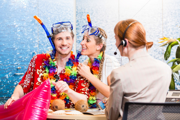 Stock photo: Man and woman booking beach holiday