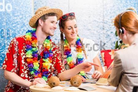 Man and woman booking holiday trip Stock photo © Kzenon
