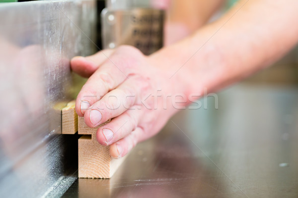 Carpenter with electric cutter Stock photo © Kzenon