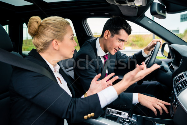 Man being lost in car, woman yelling at him Stock photo © Kzenon