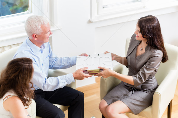 Financial consulting - customer handing over documents Stock photo © Kzenon