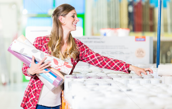 Woman buying wallpapers in do.it-yourself store Stock photo © Kzenon