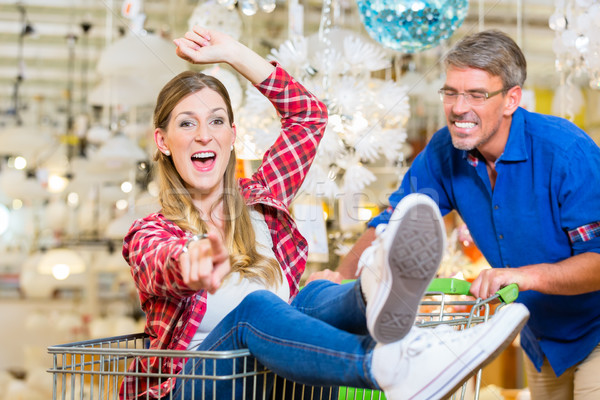 Man pushing woman in shopping cart trough hardware store Stock photo © Kzenon