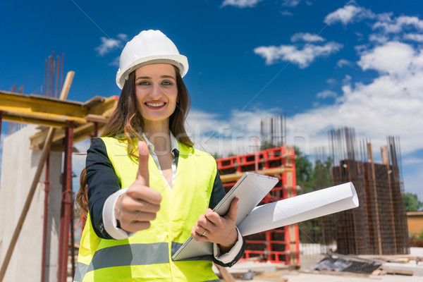 Portrait of a happy female construction foreman or architect sho Stock photo © Kzenon