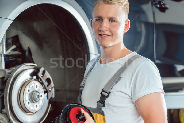 Dedicated mechanic working in a modern automobile repair shop wi Stock photo © Kzenon