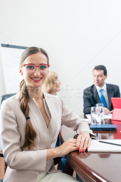Portrait of a beautiful business woman looking at camera during  Stock photo © Kzenon