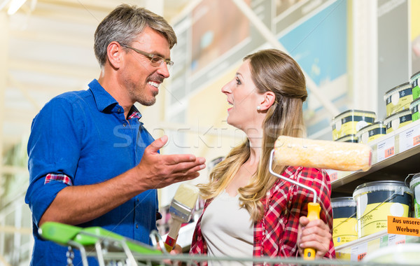 Home improver couple buying paint and painter tools in hardware  Stock photo © Kzenon