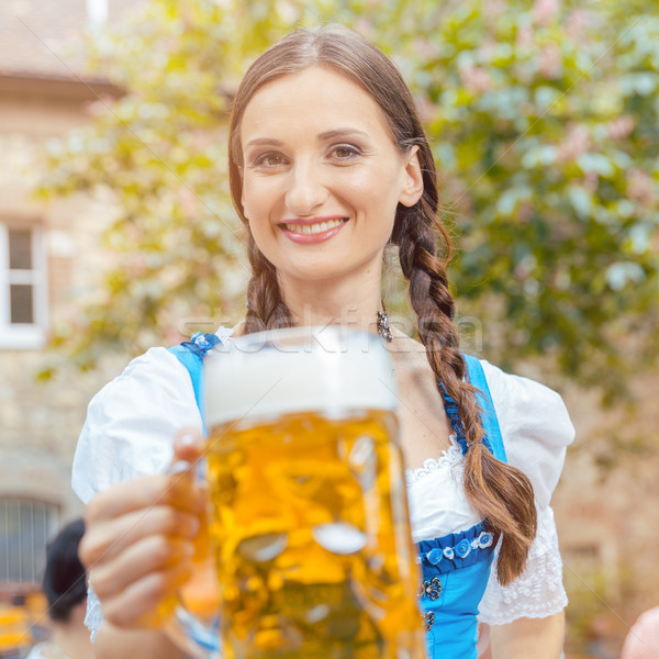 Woman wearing Dirndl drinking beer  Stock photo © Kzenon