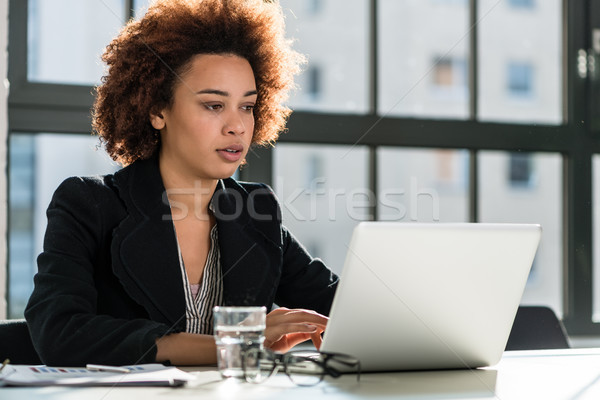 Woman working on laptop in the office Stock photo © Kzenon