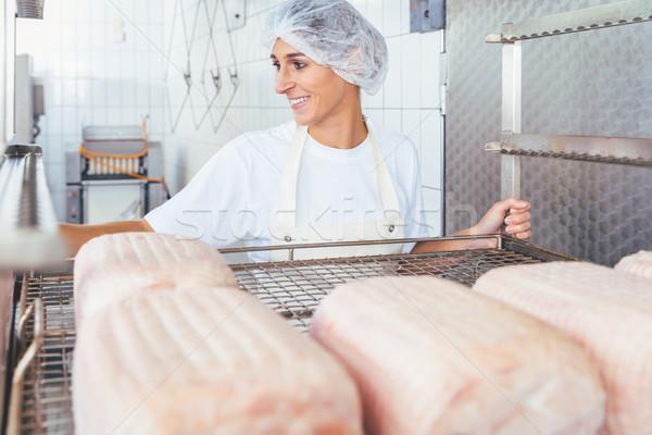 Woman in butchery processing meat Stock photo © Kzenon