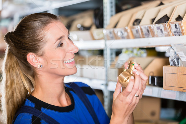 Happy blue-collar worker holding a high-quality pipe fitting accessory Stock photo © Kzenon