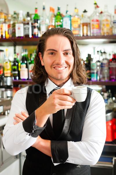 Barista in his cafe or coffeeshop Stock photo © Kzenon