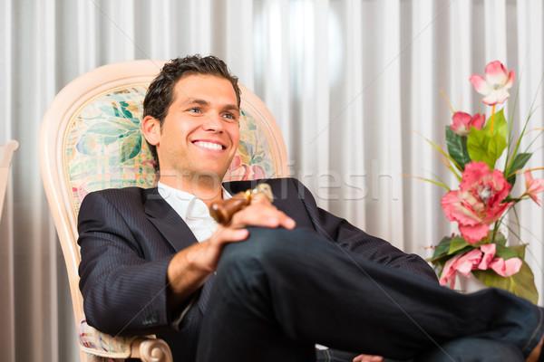 Moço sessão cadeira quarto de hotel homem quarto Foto stock © Kzenon