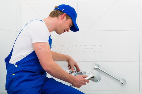 Plumber repairing shower in bath room Stock photo © Kzenon