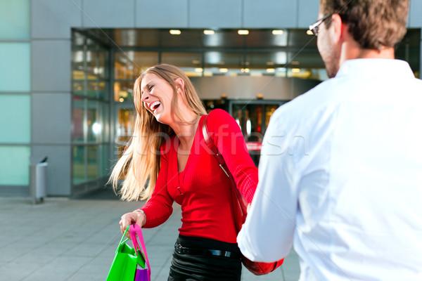 Woman dragging man into shopping mall Stock photo © Kzenon