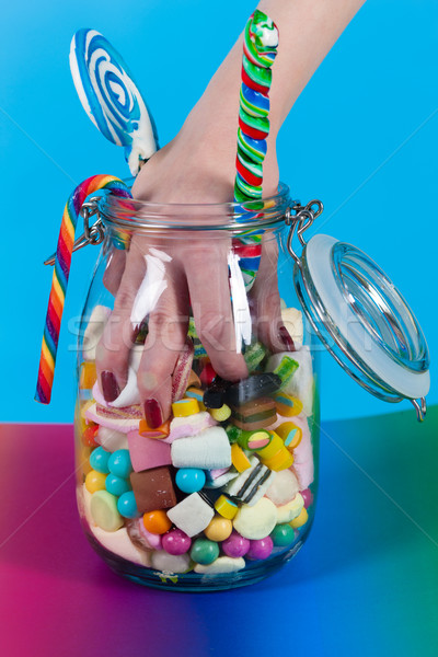 Girl with sweet goodies and candy Stock photo © Kzenon