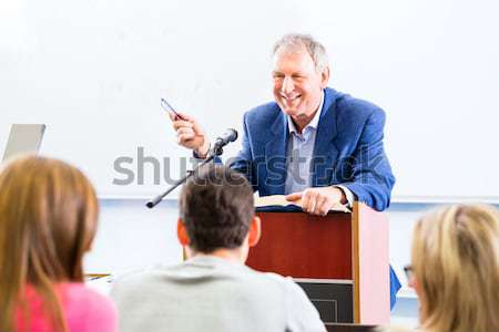 College students in lecture with professor Stock photo © Kzenon