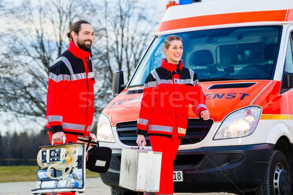 Emergency doctor in front of ambulance   Stock photo © Kzenon