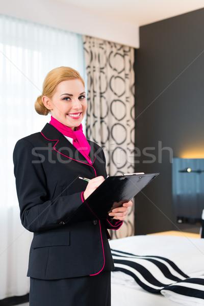 Housekeeper checking hotel room Stock photo © Kzenon