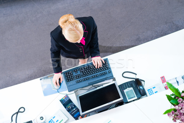 Hotel receptionist working at front office Stock photo © Kzenon