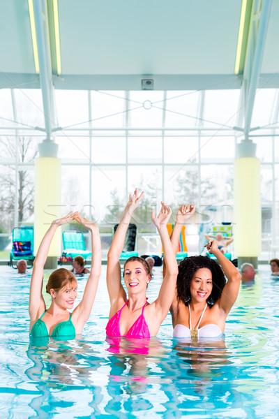 Women swimming in indoor public pool Stock photo © Kzenon