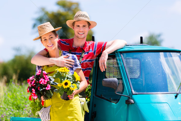 Couple in garden with flowers on gape Stock photo © Kzenon