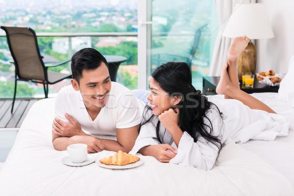 Asya çift kahvaltı yatak kruvasan kahve Stok fotoğraf © Kzenon