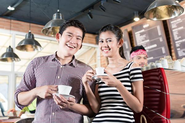 ázsiai pár iszik cappucchino kávéház nő Stock fotó © Kzenon