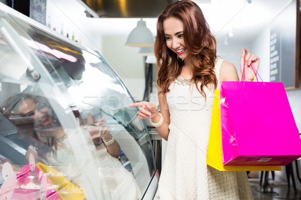 Stylish young female shopper making a selection Stock photo © Kzenon