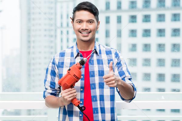 молодые индонезийский человека власти дрель готовый Сток-фото © Kzenon