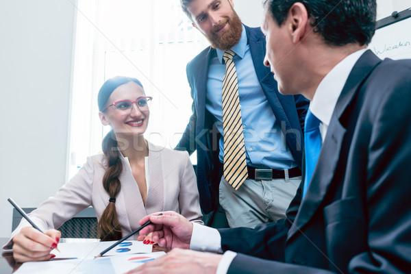 Negócio analista sorridente financeiro relatórios Foto stock © Kzenon