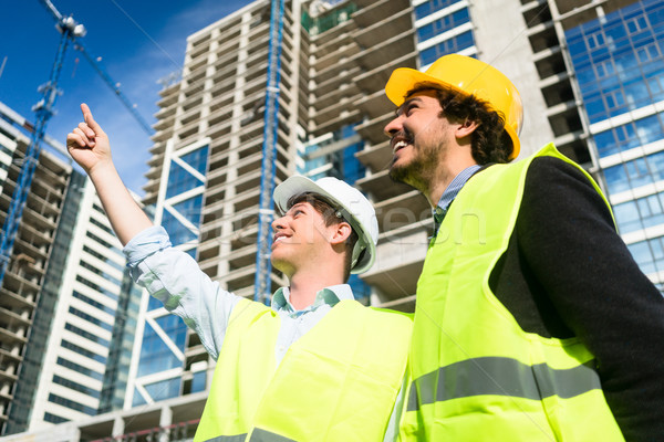Architects on large construction site giving instructions Stock photo © Kzenon