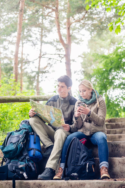 Hiking couple having break on forest trail  Stock photo © Kzenon
