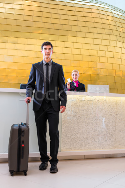 Man departing on business trip at hotel reception  Stock photo © Kzenon