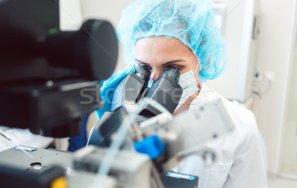 Woman scientist working on microscope  Stock photo © Kzenon