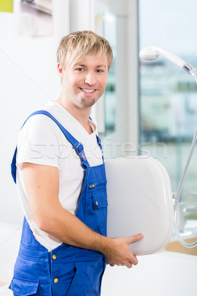 Portrait of a cheerful man working in a sanitary ware shop Stock photo © Kzenon