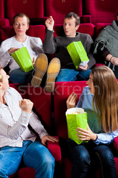 People eating popcorn in theatre Stock photo © Kzenon